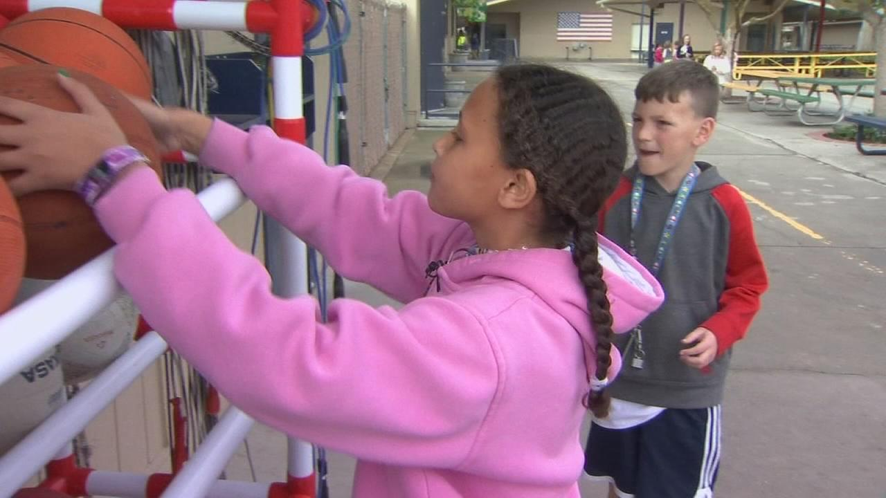 Elementary school children learn the value of a job
