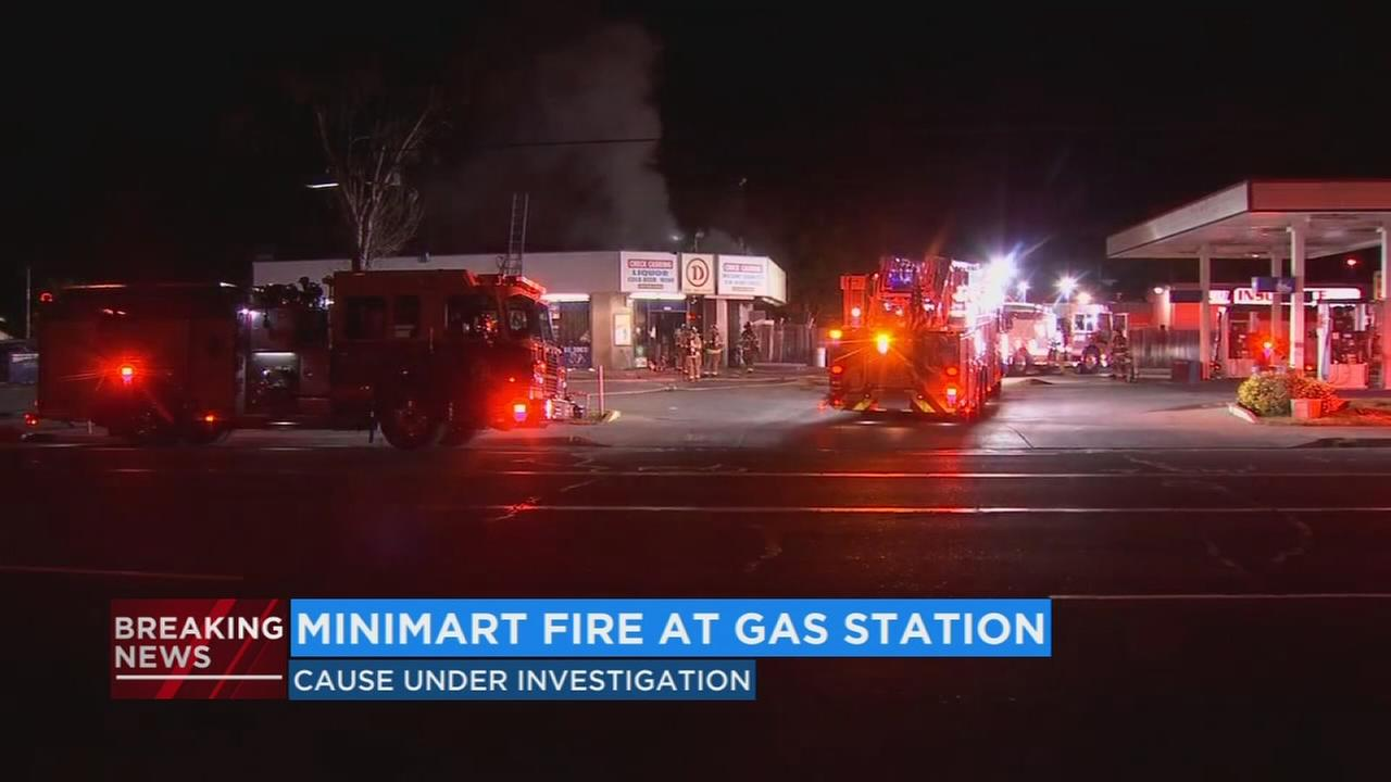 Crews battle fire at convenience store in Central Fresno