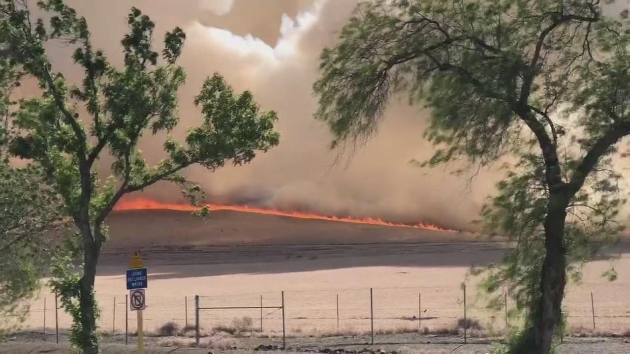 Brush fire burns Fresno and Merced County