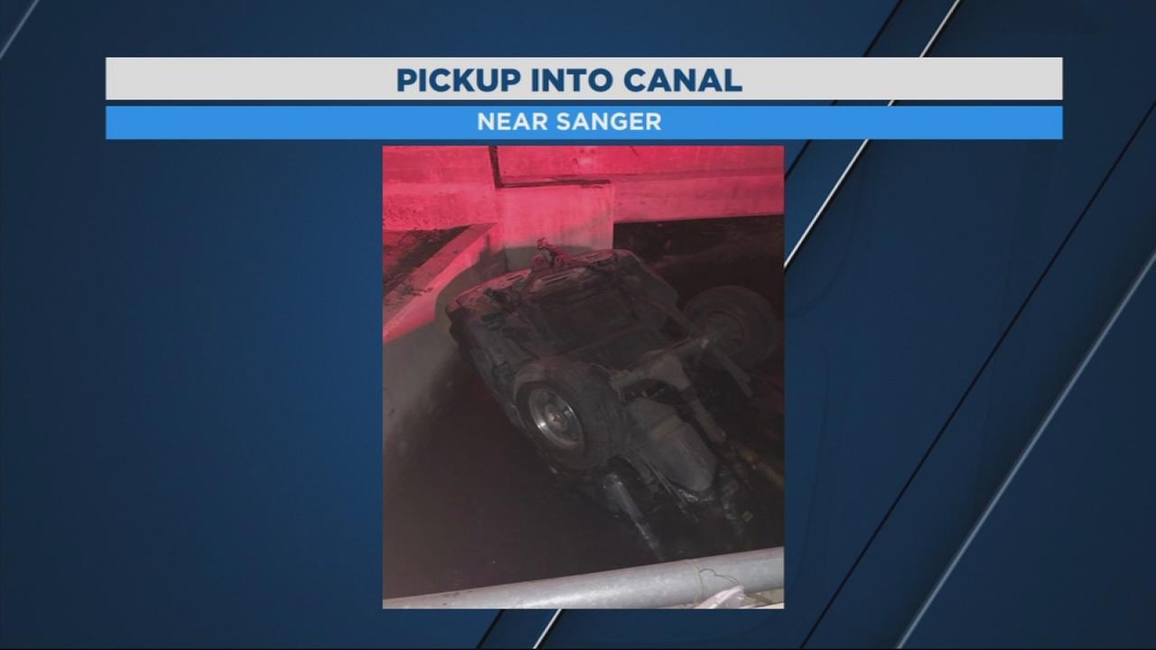 Crash sends truck into canal near Sanger