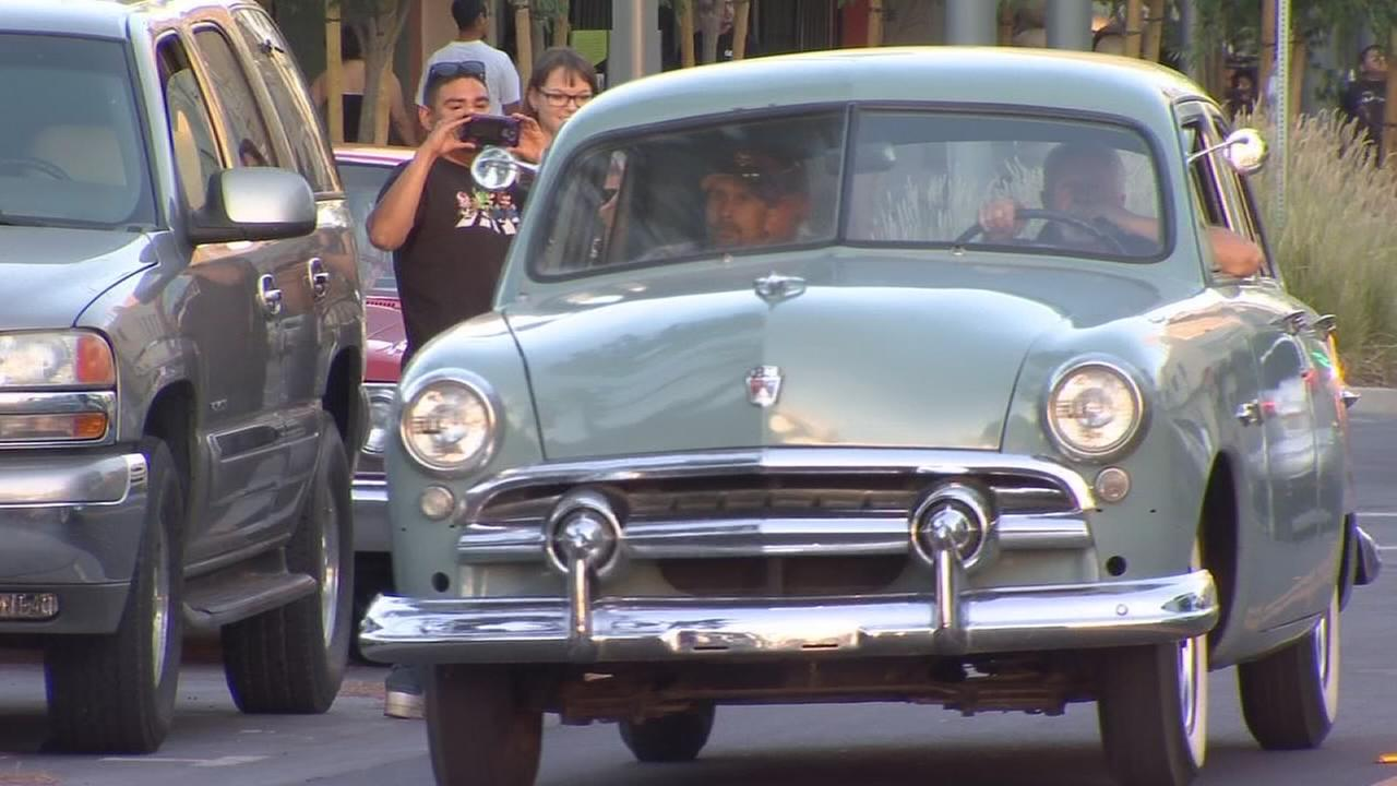 Hundreds of classic, custom and low rider cars and trucks dragging the main