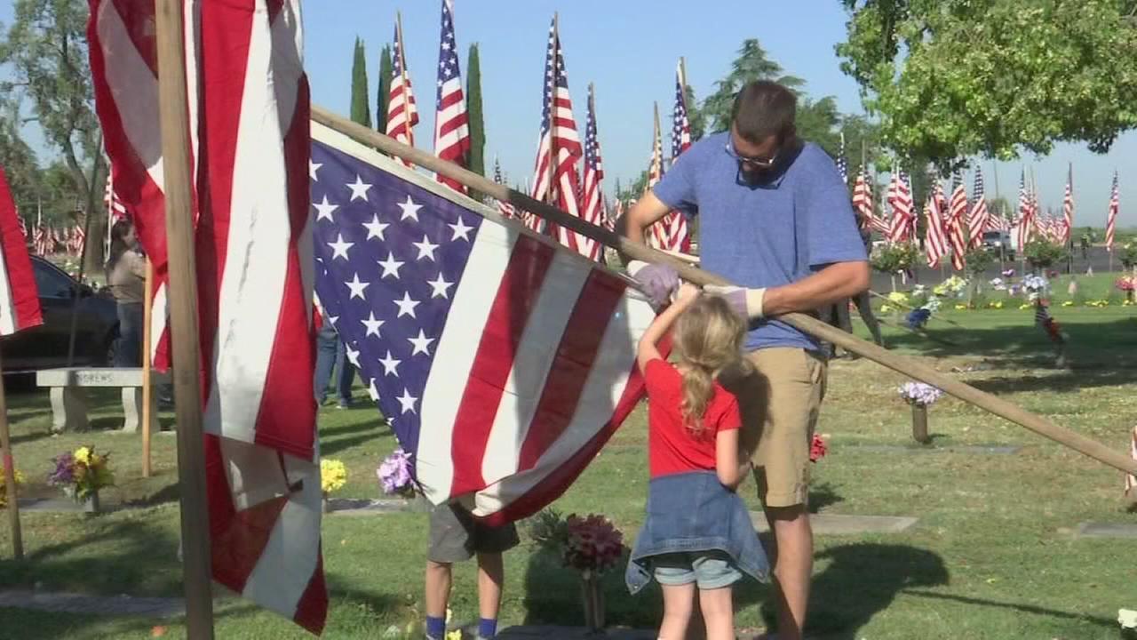 Dozens of volunteers honor fallen solders at Fresno Memorial Gardens