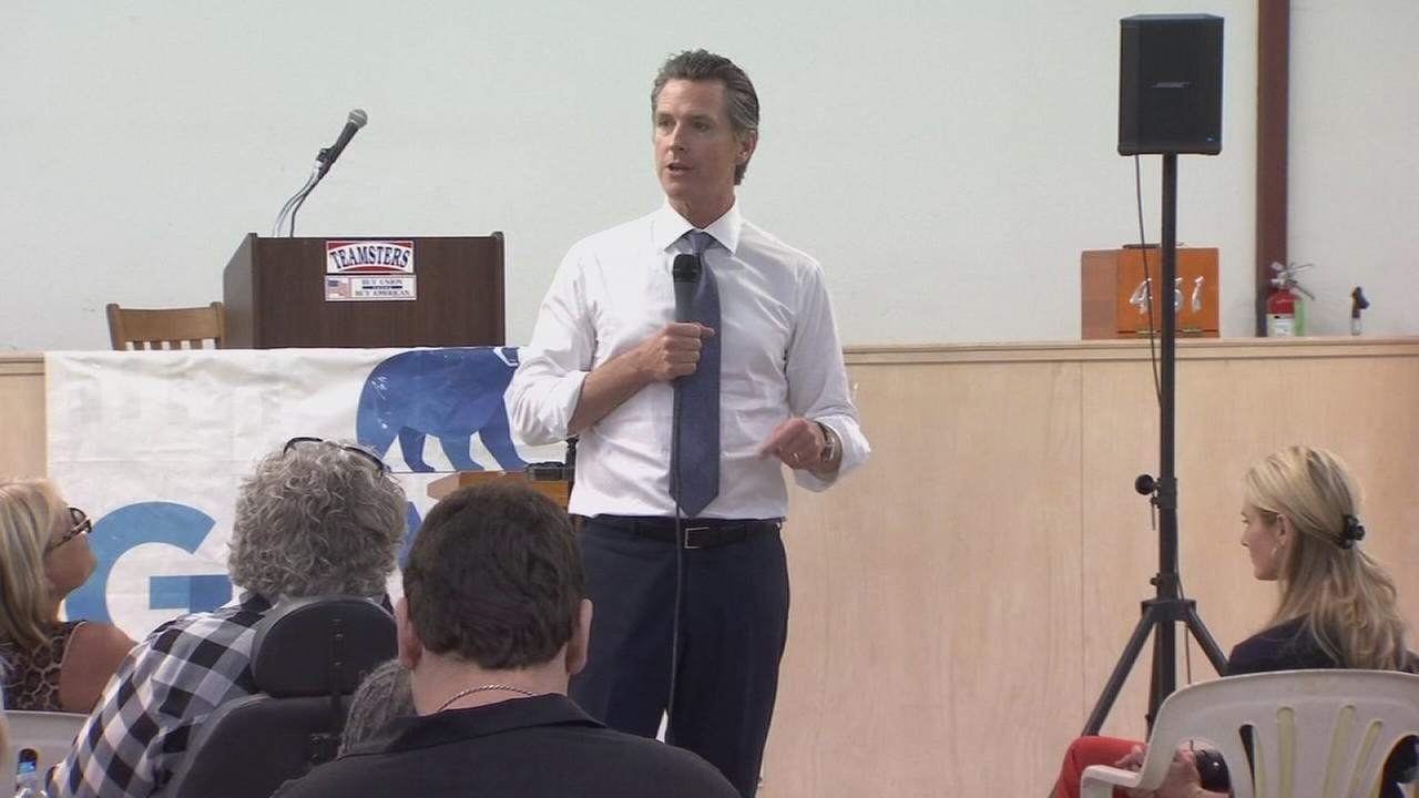 Gavin Newsom met by protesters in Valley