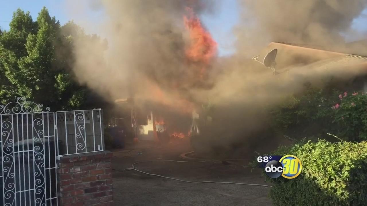 Caught on video: Dad rescued from burning Central Fresno home