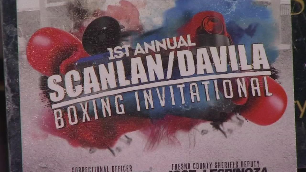 Law enforcement officers boxing to help colleagues