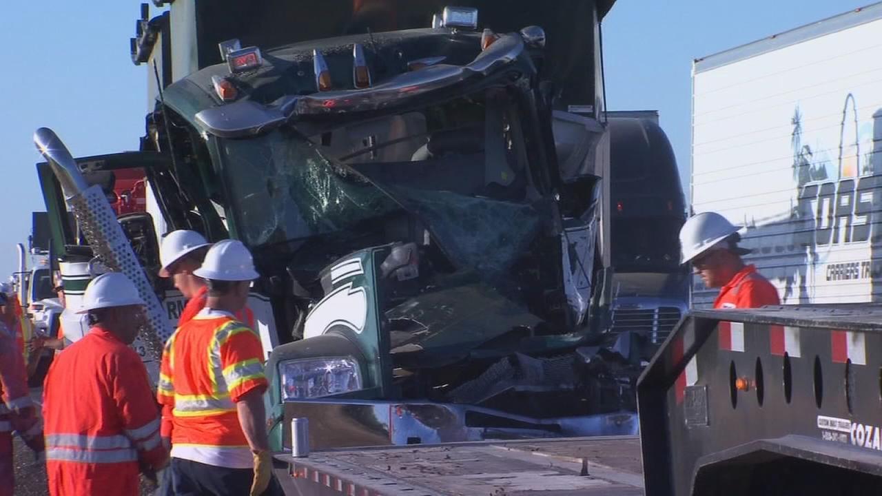 Big rigs collide near Coalinga pinning one driver in