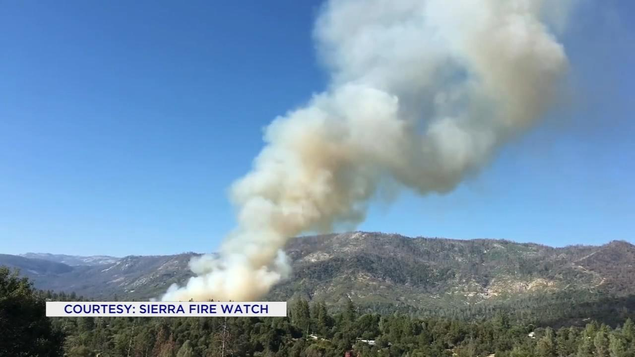 Firefighters working to contain the School Fire in Madera County