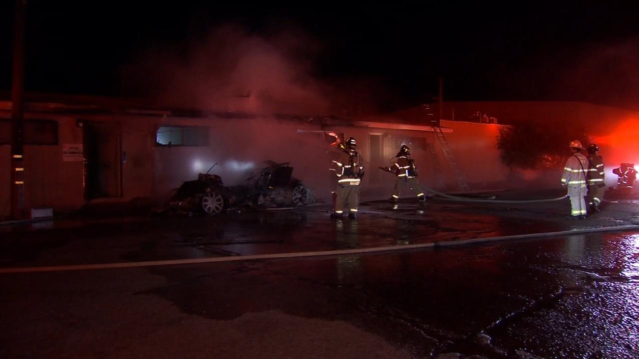 SUV catches fire in Southeast Fresno, spreads to nearby business