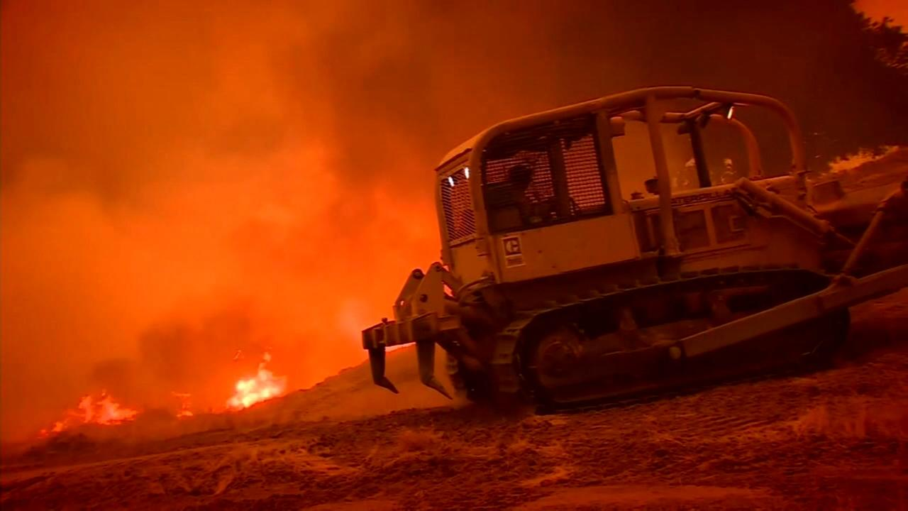 Bulldozer operators give fire crews a fighting chance