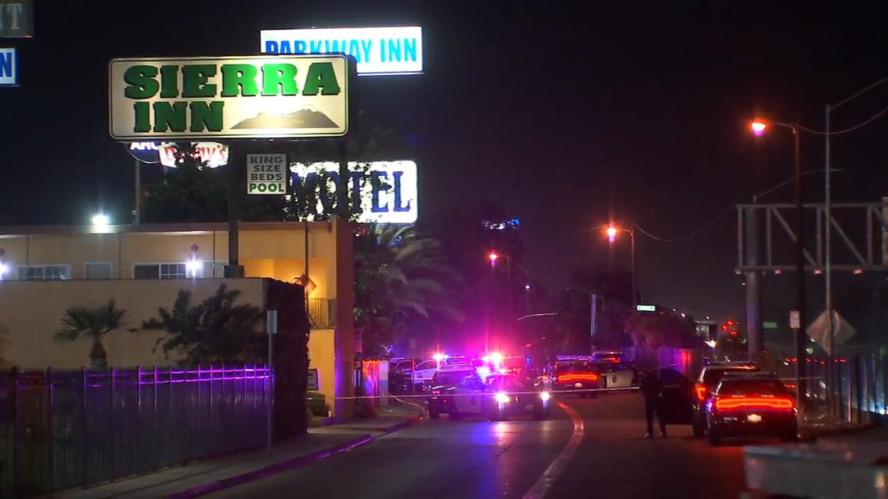 Large police response amid an active standoff with shots fired at motel