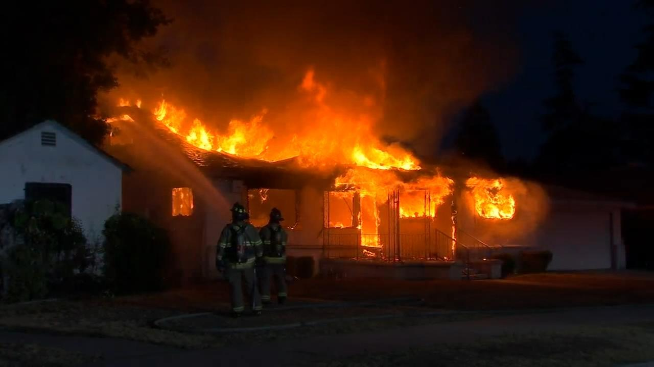 Firefighters battle house fire in Southwest Fresno