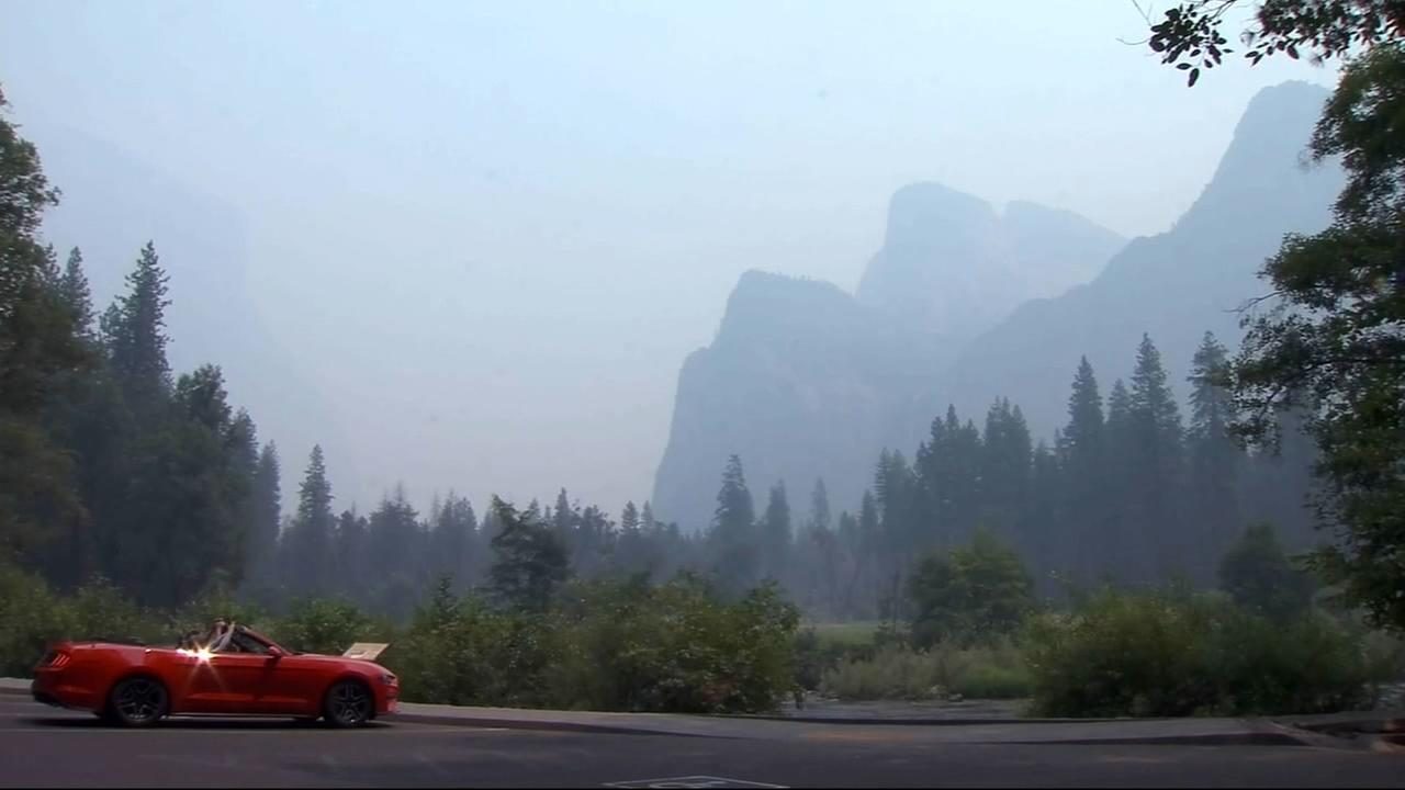 FILE - The iconic vistas of the Yosemite Valley are obscured by thick smoke from the Ferguson Fire in this July 24 image.
