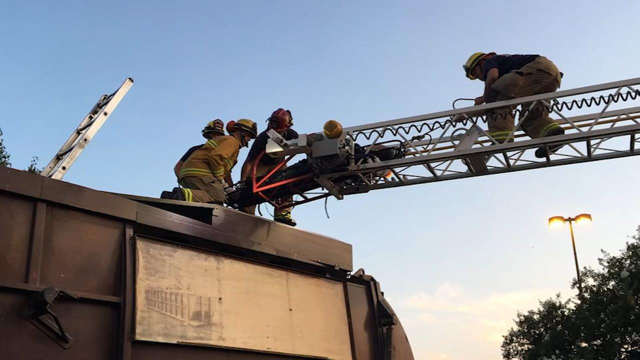Fire crews rescue man from a garbage truck after he fell asleep in trash bin in Visalia