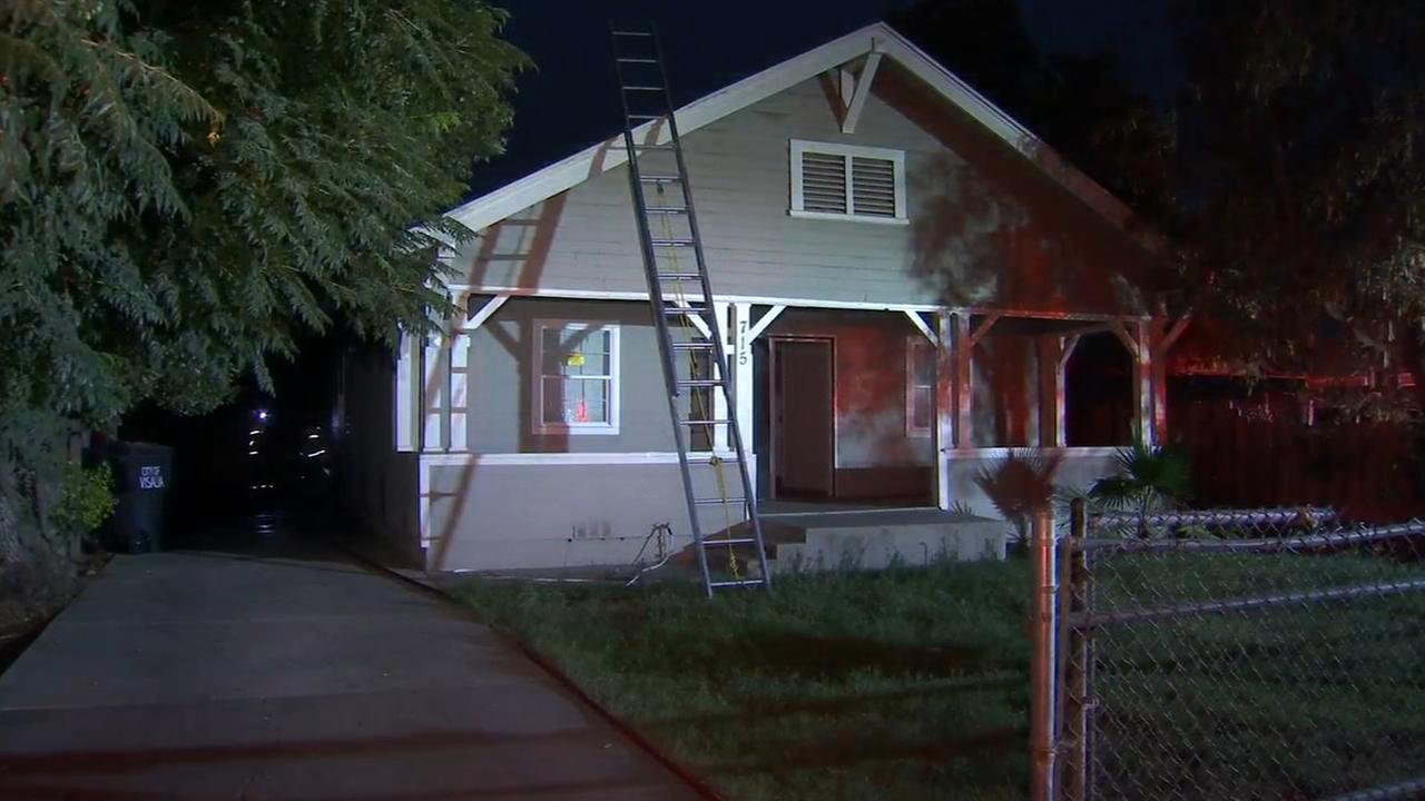 Firefighters battle Visalia house fire