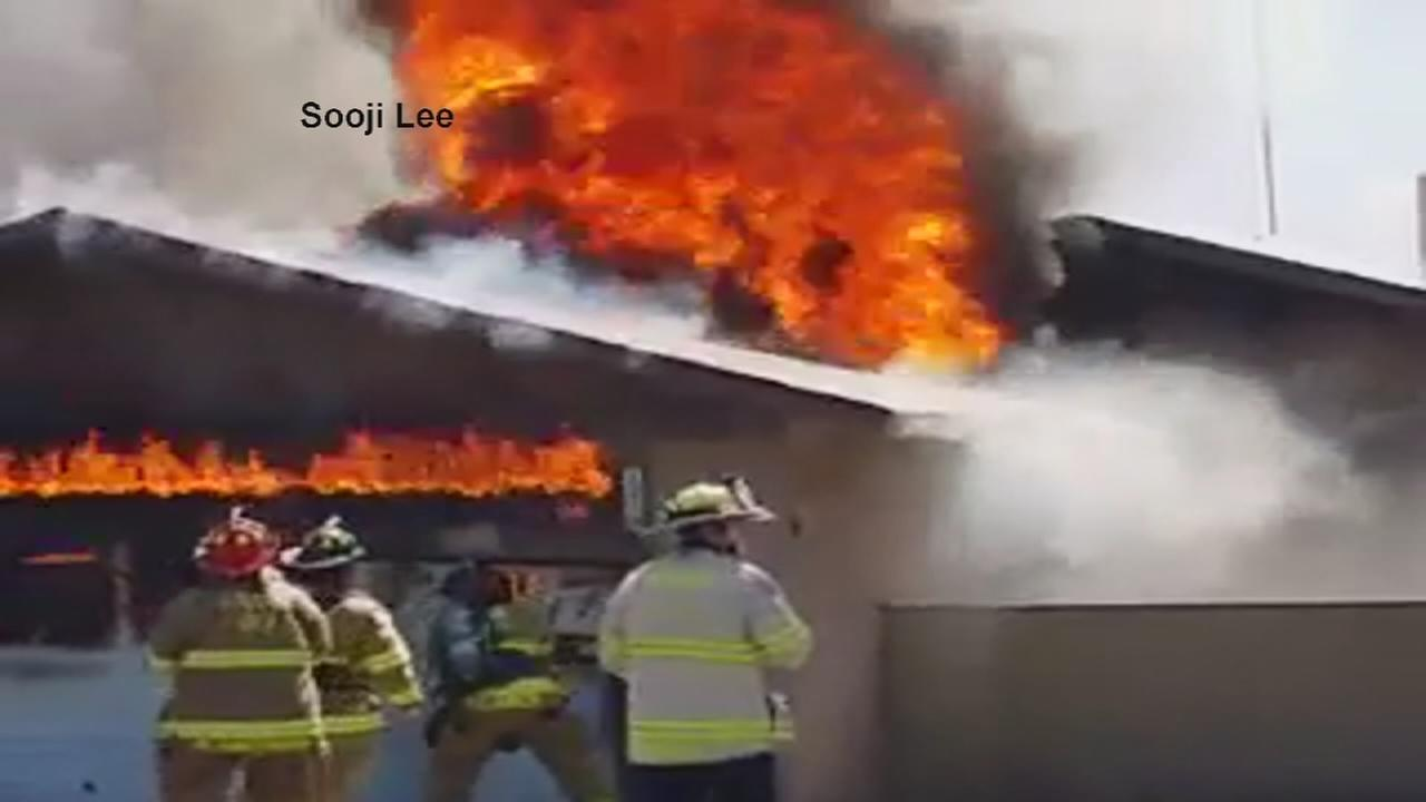 RAW VIDEO: Firefighter falls through roof while battling Fresno house fire