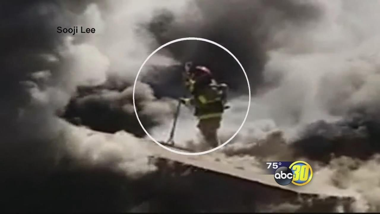 Fresno firefighter critical after falling through roof of burning home