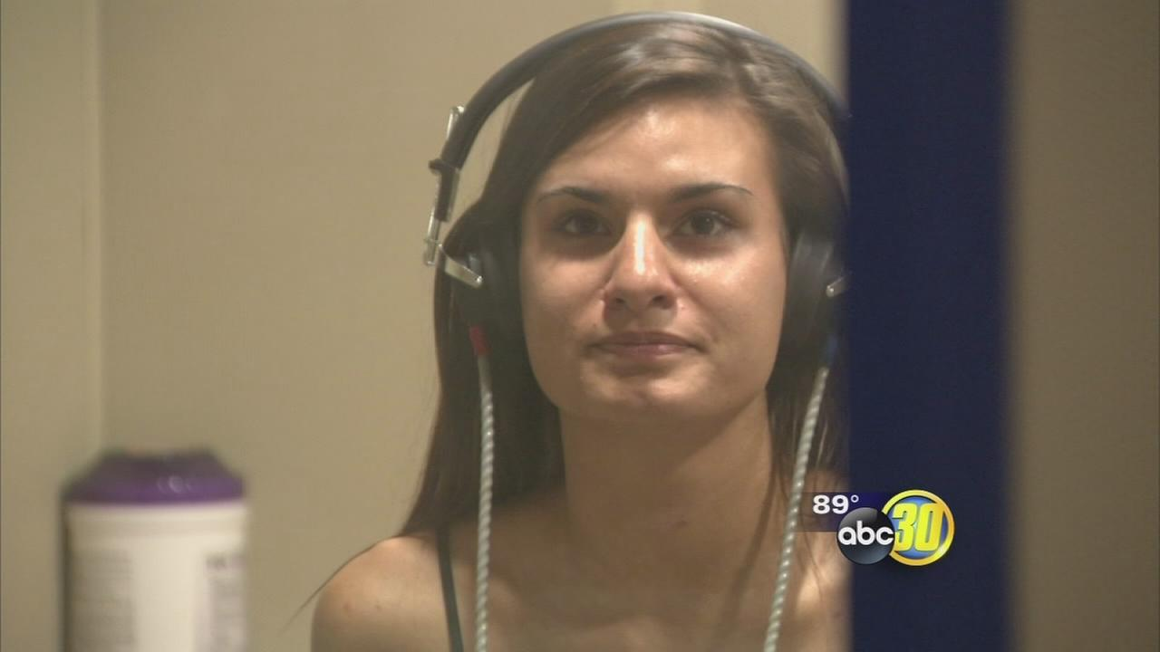 Theft victim gets new hearing device programmed