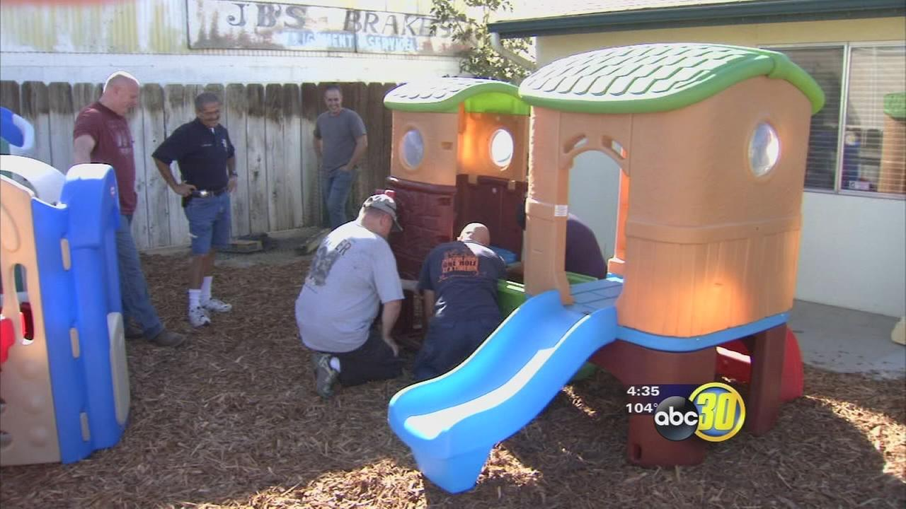 Hanford police officers build playsets for children with special needs after theft