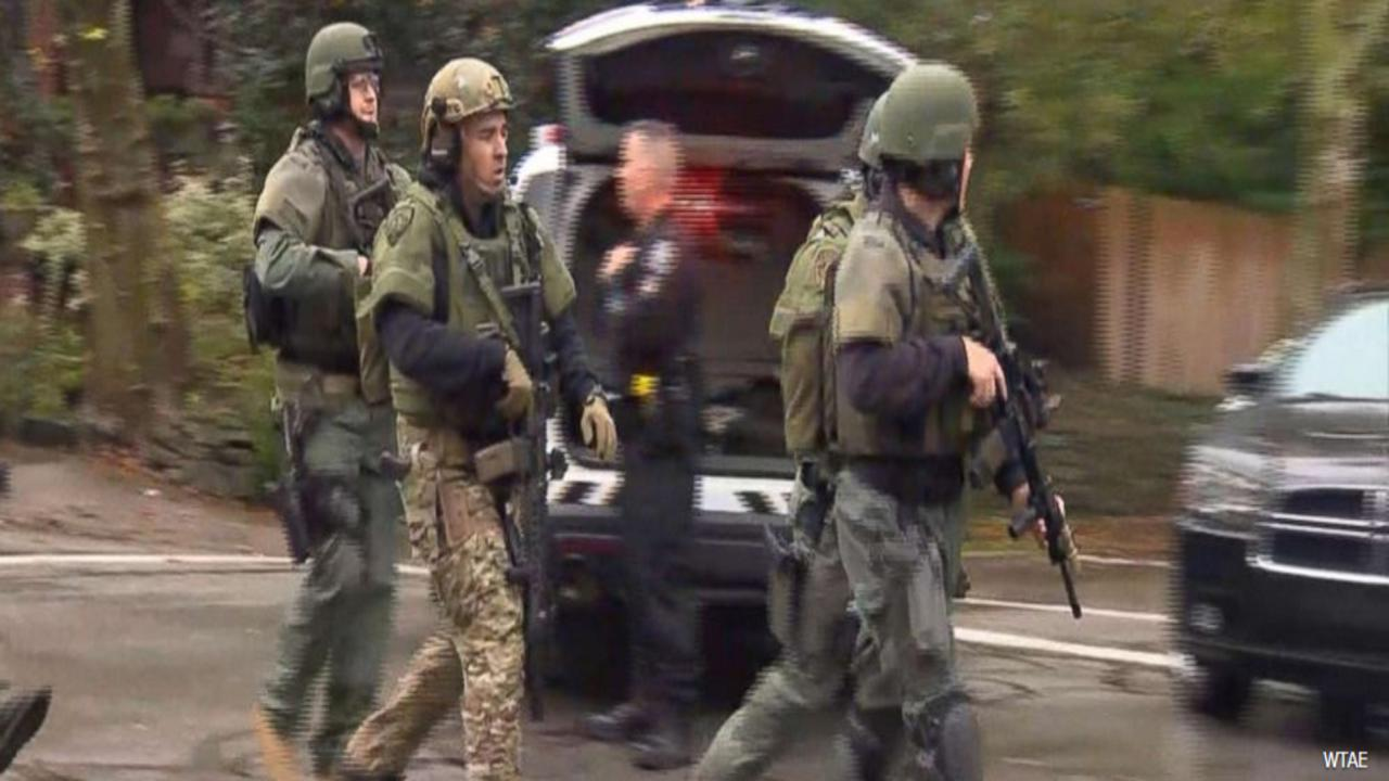 Pittsburgh police report 'multiple casualties' in shooting at synagogue, 4 officers shot