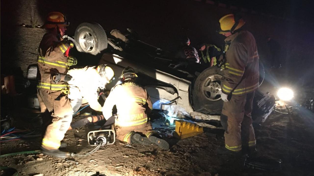 Visalia car crash injures four, pins one under a flipped car