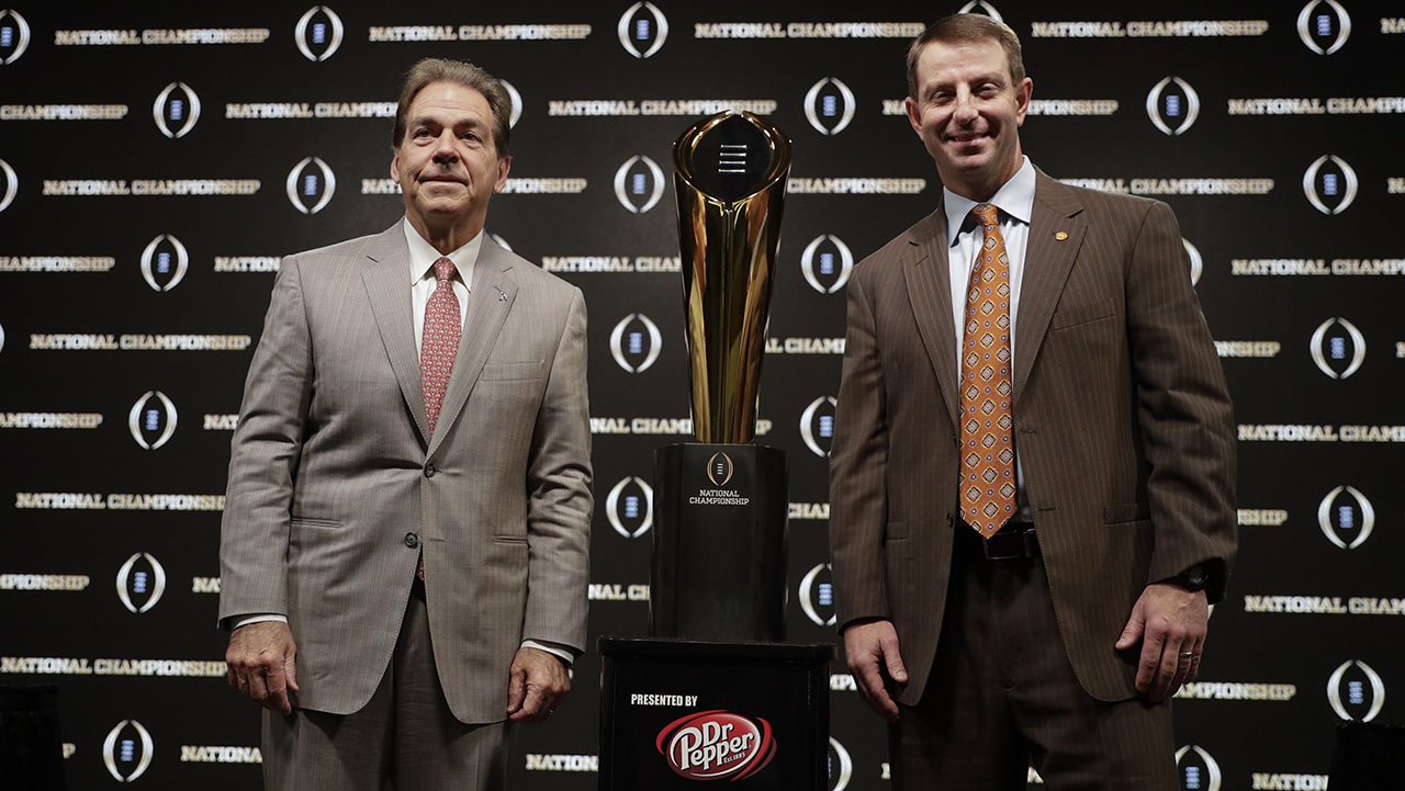 Alabama coach Nick Saban and Clemson coach Dabo Swinney pose at news conference for the NCAA college football playoff championship game Sunday, Jan. 6, 2019, in Santa Clara, Calif.