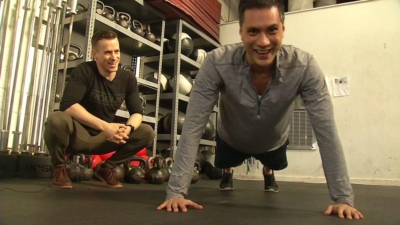 This undated image shows ABC7s Reggie Aqui and trainer Jon Hanna in San Francisco.
