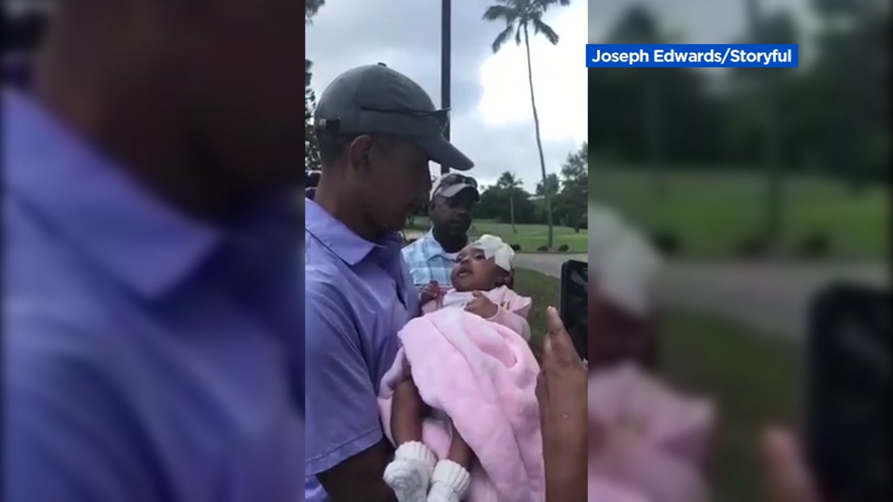 Former President Barack Obama delighted two parents in Hawaii when he took a moment to hold their newborn daughter while at a golf club.