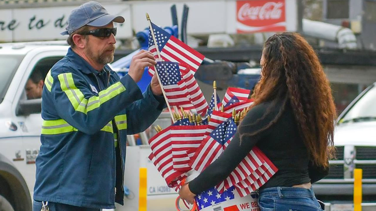 Flags are handed out in Davis, Calif. on Friday, Jan. 11, 2019 in honor of fallen Officer Natalie Corona.