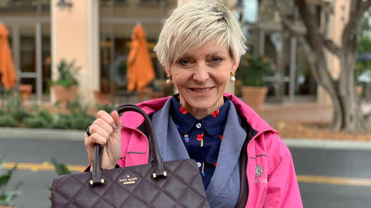 Christine Ibanez holds her Kate Spade handbag in this undated image.