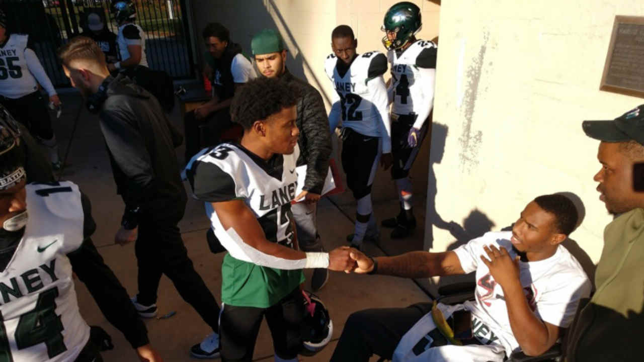 Members of the Laney College football team are seen meeting with fellow player Ramone Sanders in Oakland, Calif. on Monday, Jan. 14, 2019.