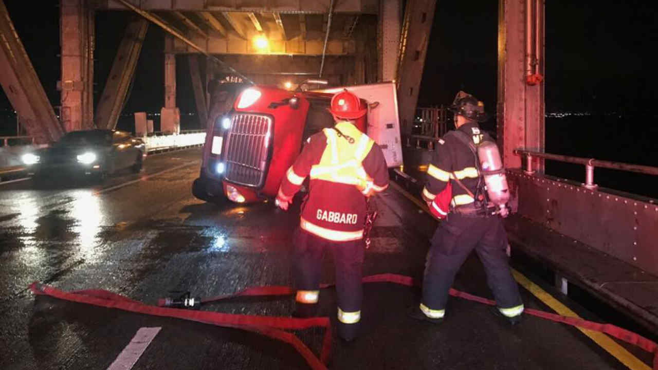 An overturned big rig is seen blocking lanes of the Richmond-San Rafael Bridge on Wednesday, Jan. 16, 2019.