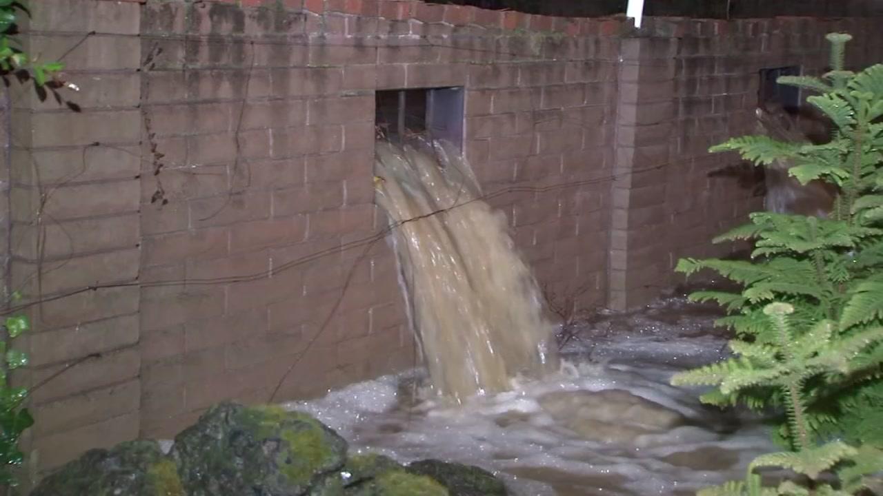 Rain floods into a homes backyard in Saratoga, Calif. on Wednesday, Jan. 16, 2019.