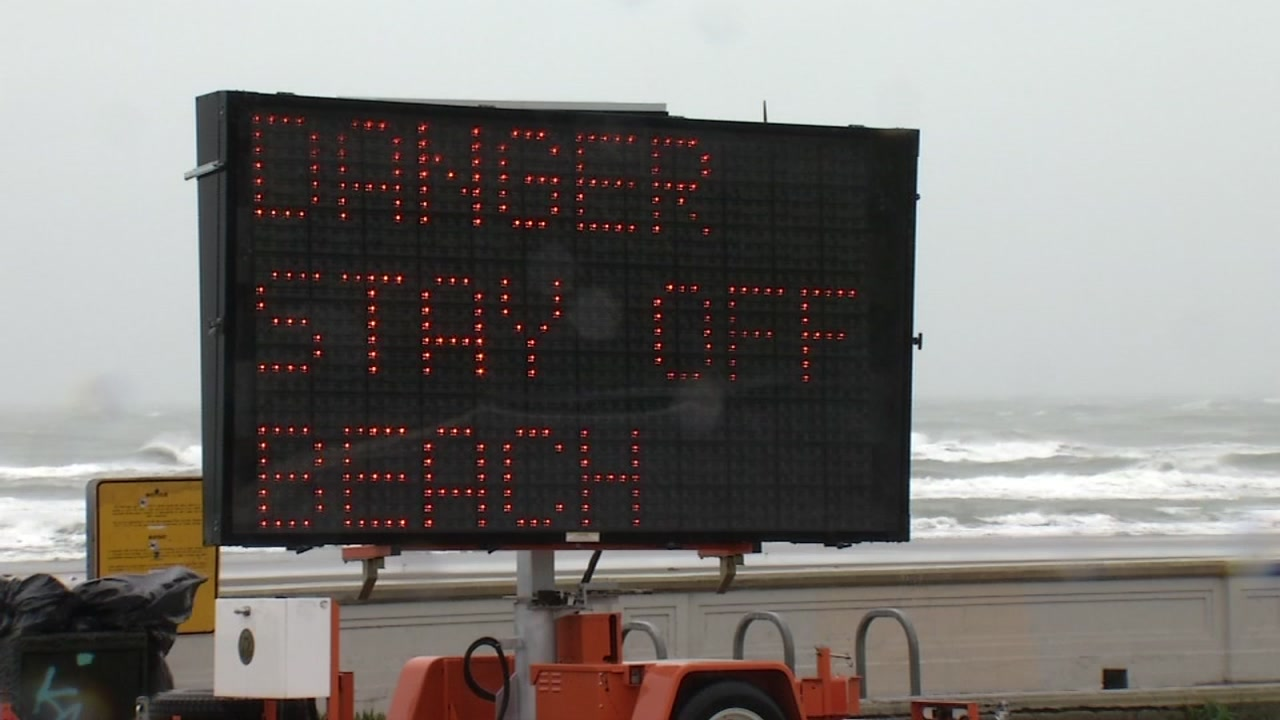 A sign is warning visitors to stay off the beach at Ocean Beach in San Francisco on Wednesday, Jan. 16, 2019.
