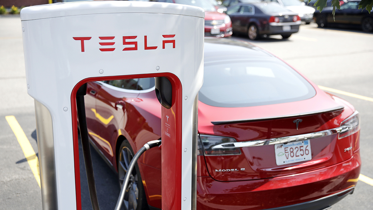 In this Aug. 24, 2018, file photo a Tesla Model S is plugged in at a vehicle Supercharging station in Seabrook, N.H.