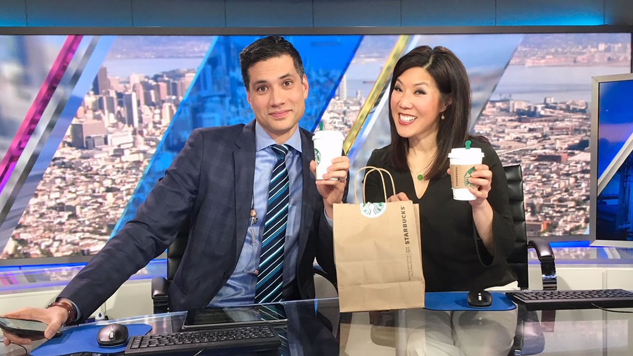 ABC7s Reggie Aqui and Kristen Sze hold up their delivered Starbucks drinks following Midday Live on Tuesday, Jan. 22, 2019.
