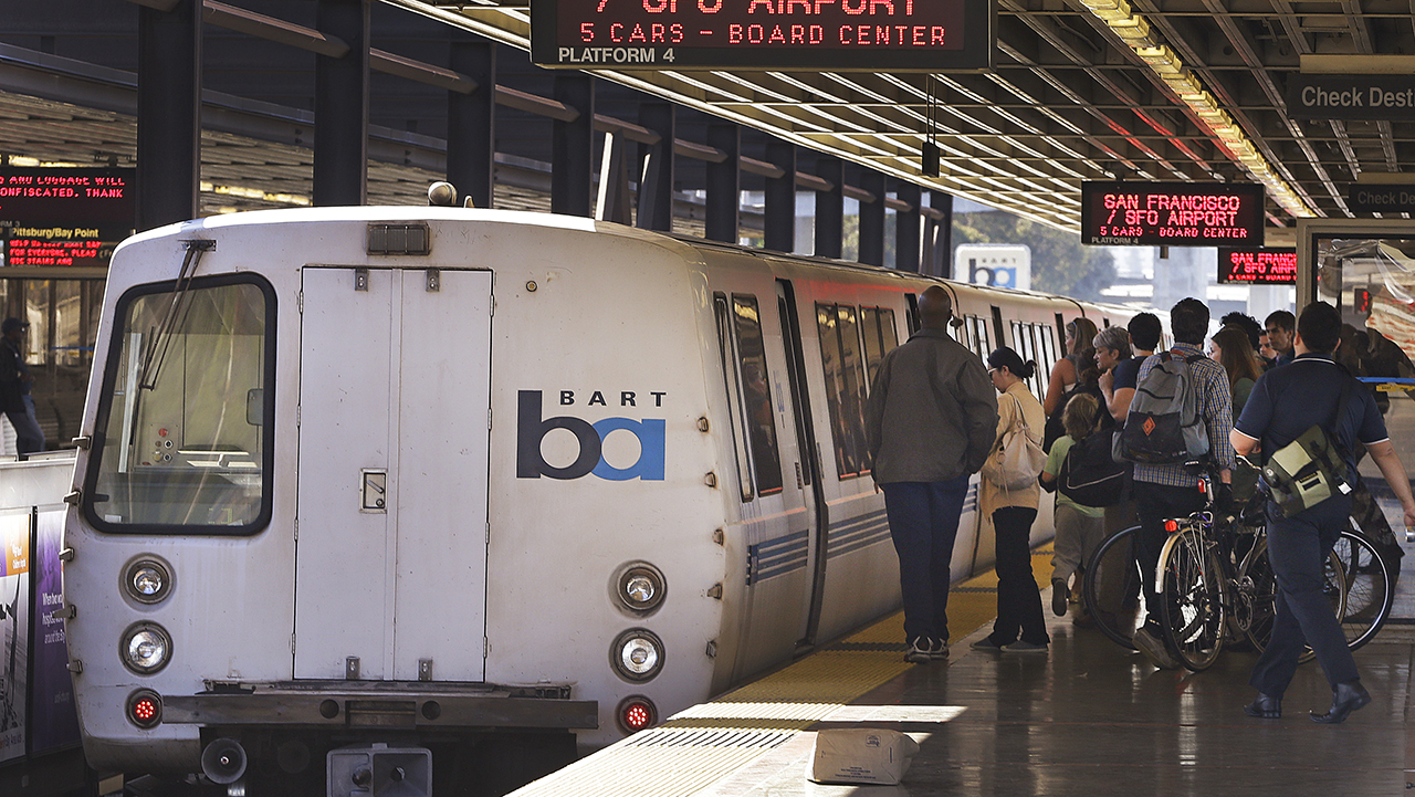 FILE - In this Oct. 15, 2013, file photo, passengers board a Bay Area Rapid Transit train in Oakland, Calif.