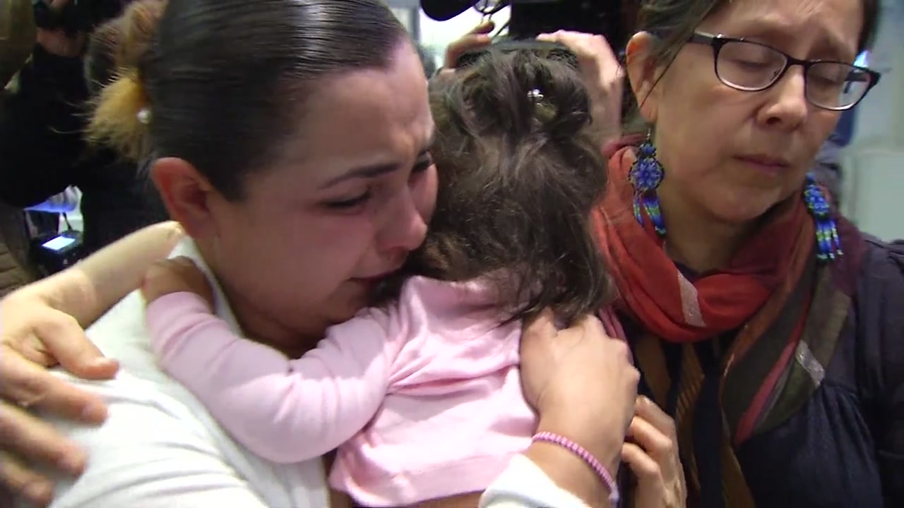 Sindy Flores hugs her 1-year-old daughter, Gretchen Juliet, at San Francisco International Airport on Tuesday, Jan. 29, 2019.