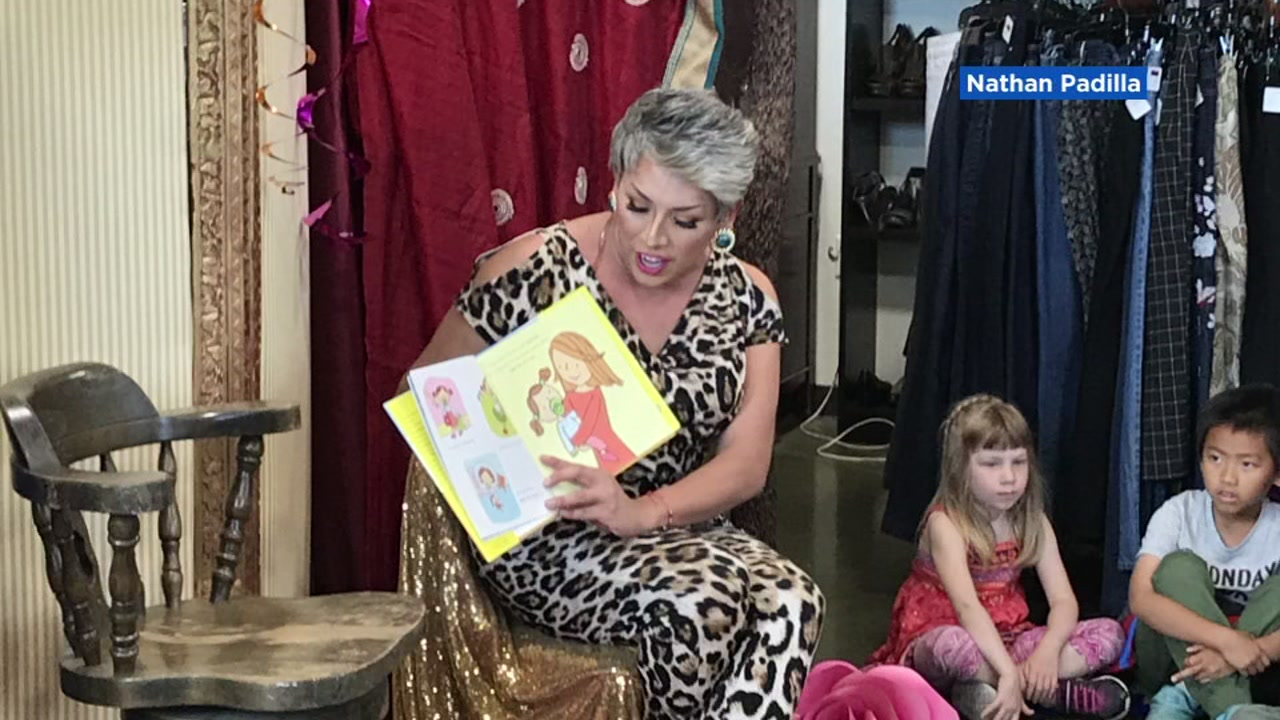 A person dressed in drag reads to children at an El Cerrito, Calif. library.