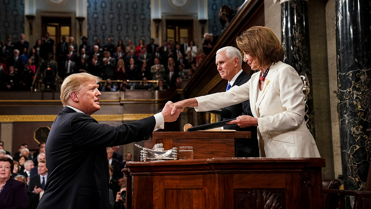 President Donald Trump shakes hands with House Speaker Nancy Pelosi as Vice President Mike Pence looks on. Tuesday, Feb. 5, 2019