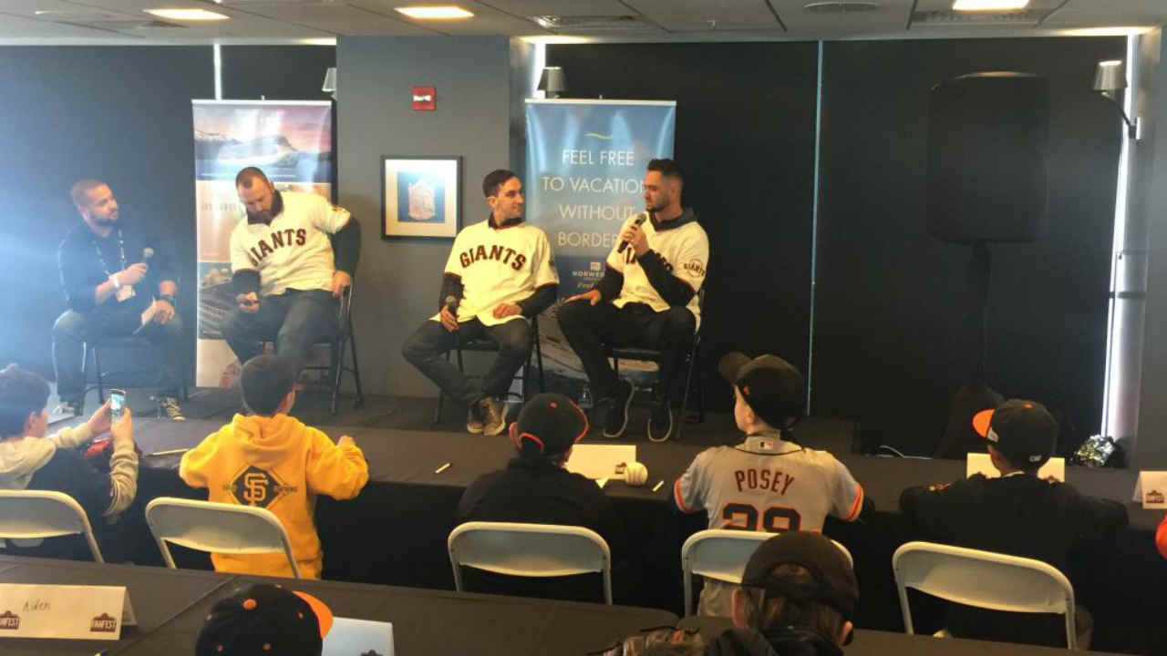 San Francisco Giants players are seen answering questions during FanFest at Oracle Park in San Francisco on Saturday, Feb. 9, 2019.