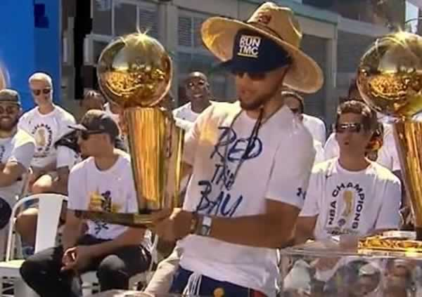 Stephen Curry holds the Larry OBrien Trophy before the Warriors victory parade in Oakland, Calif. on Tuesday, June 12, 2018.