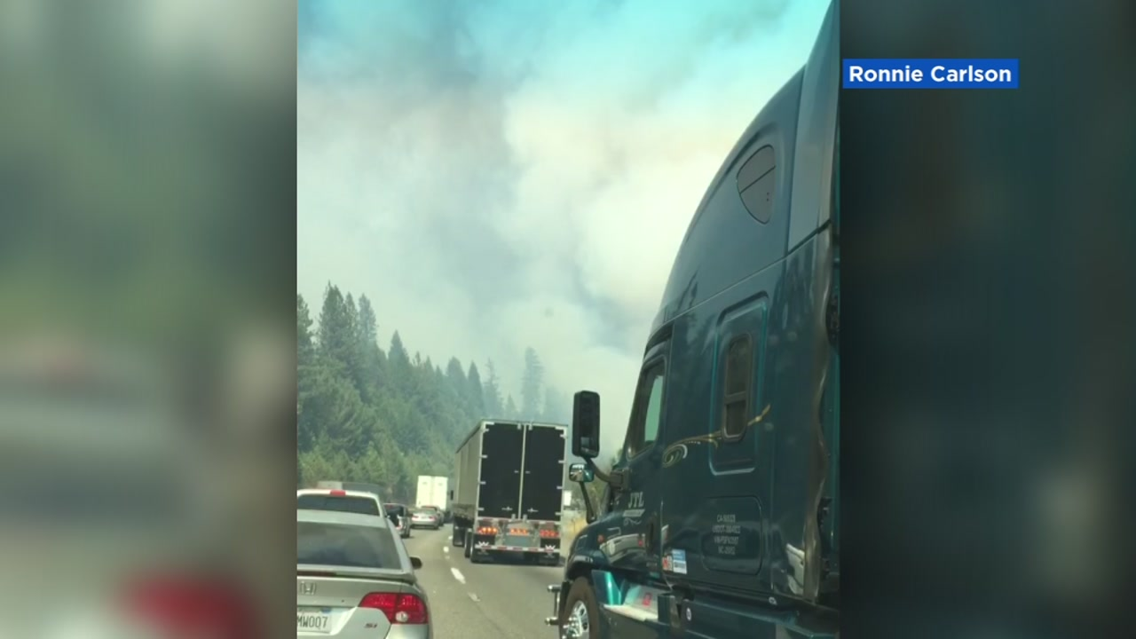Smoke from a wildfire is seen from a highway in Shasta County, Calif. on Wednesday, September 5, 2018.