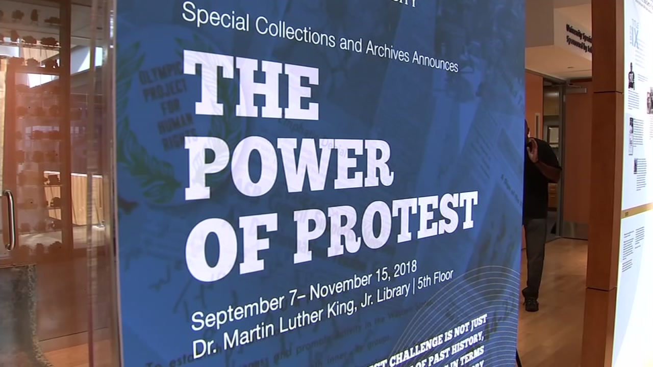 A sign for the Power of Protest exhibit at San Jose State University is seen on Sept. 6, 2018 in San Jose, Calif.