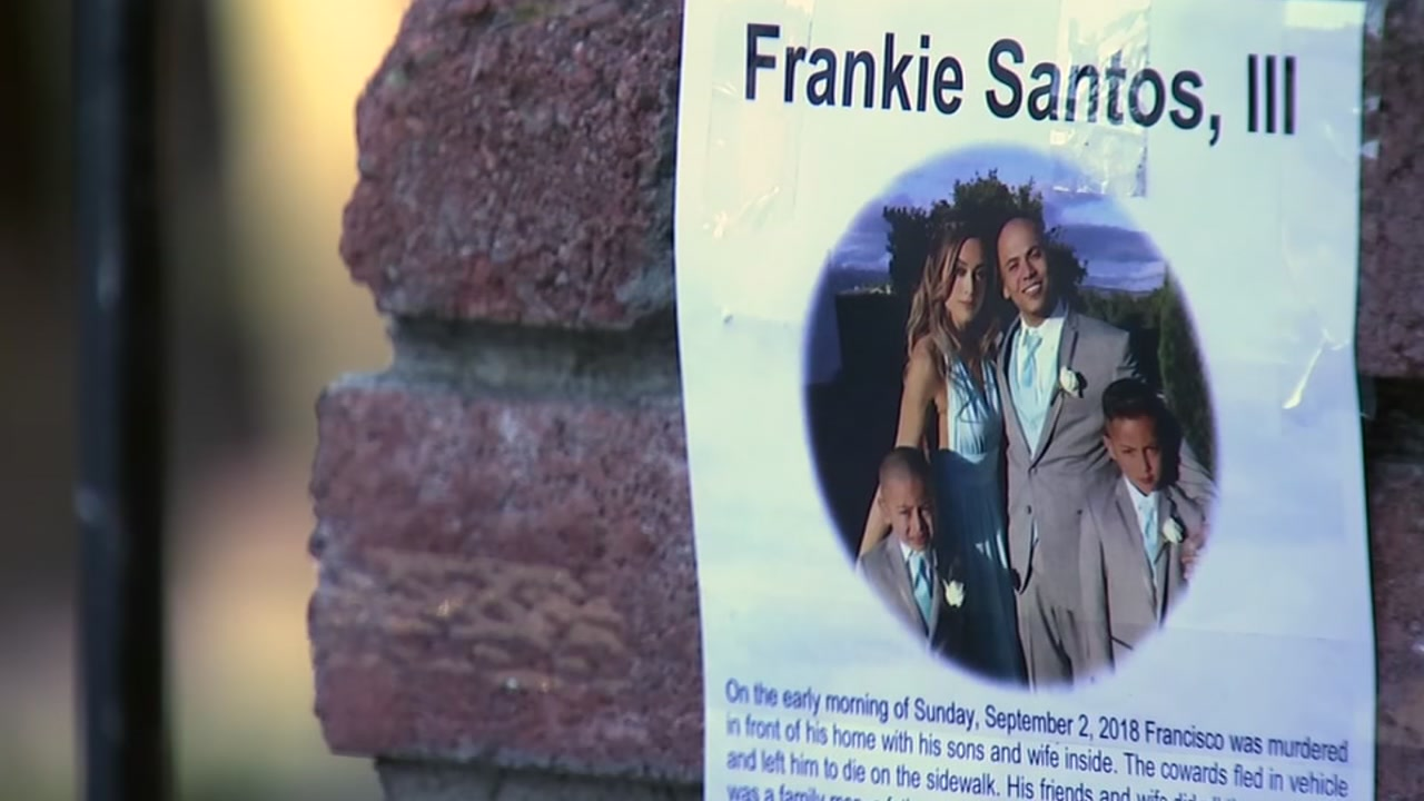 Francisco Frankie Santos, who was killed on Sunday, is pictured with his wife and two children in a memorial sign seen on Sept. 7, 2018, in San Jose, Calif.