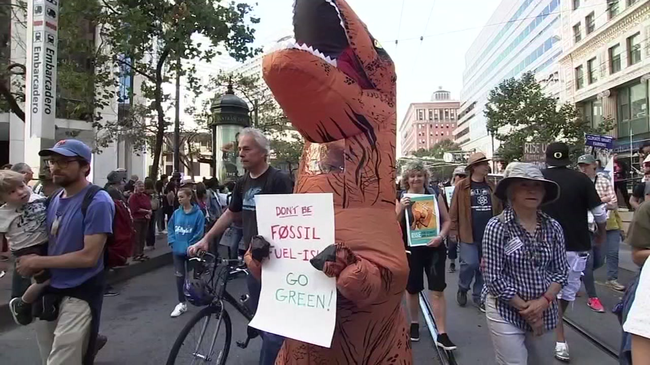 A fossil fuel dinosaur takes a stand at San Franciscos Rise for Climate march on Sept. 8, 2018.