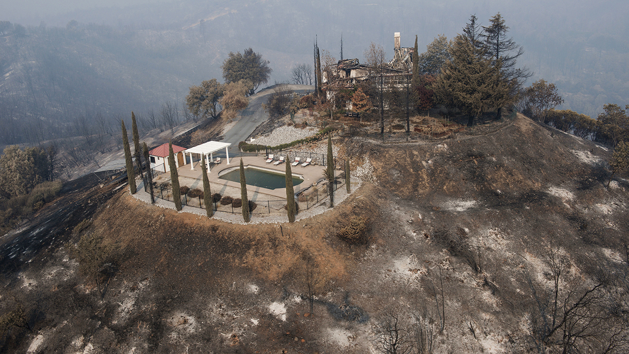 A swimming pool is all that remains of a hilltop home after being burned by a wildfire that swept through Shasta County, Friday, Aug. 10, 2018.