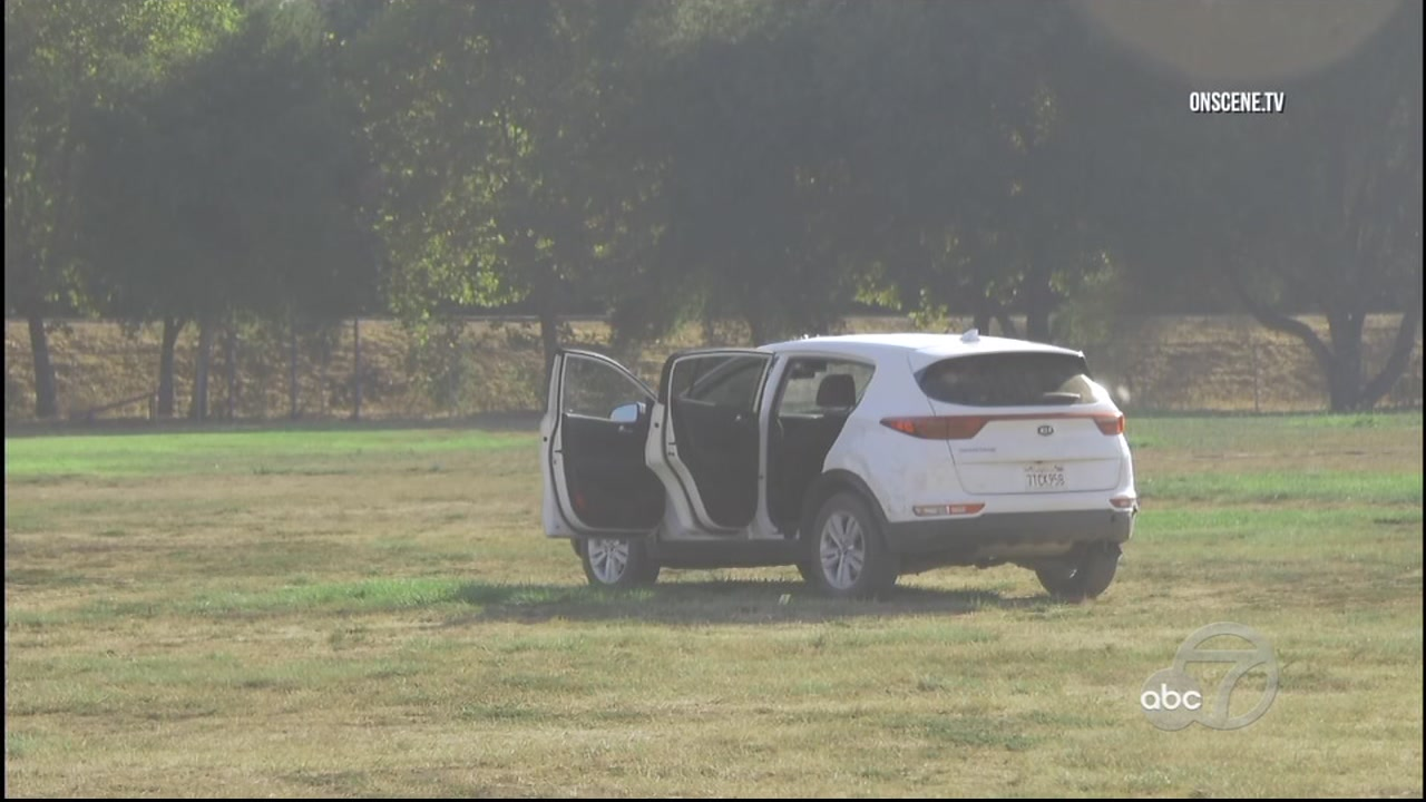 A Gilroy police officer shot at a man who was coming at him in a car on a field near where several hundred fifth and sixth graders were playing football.