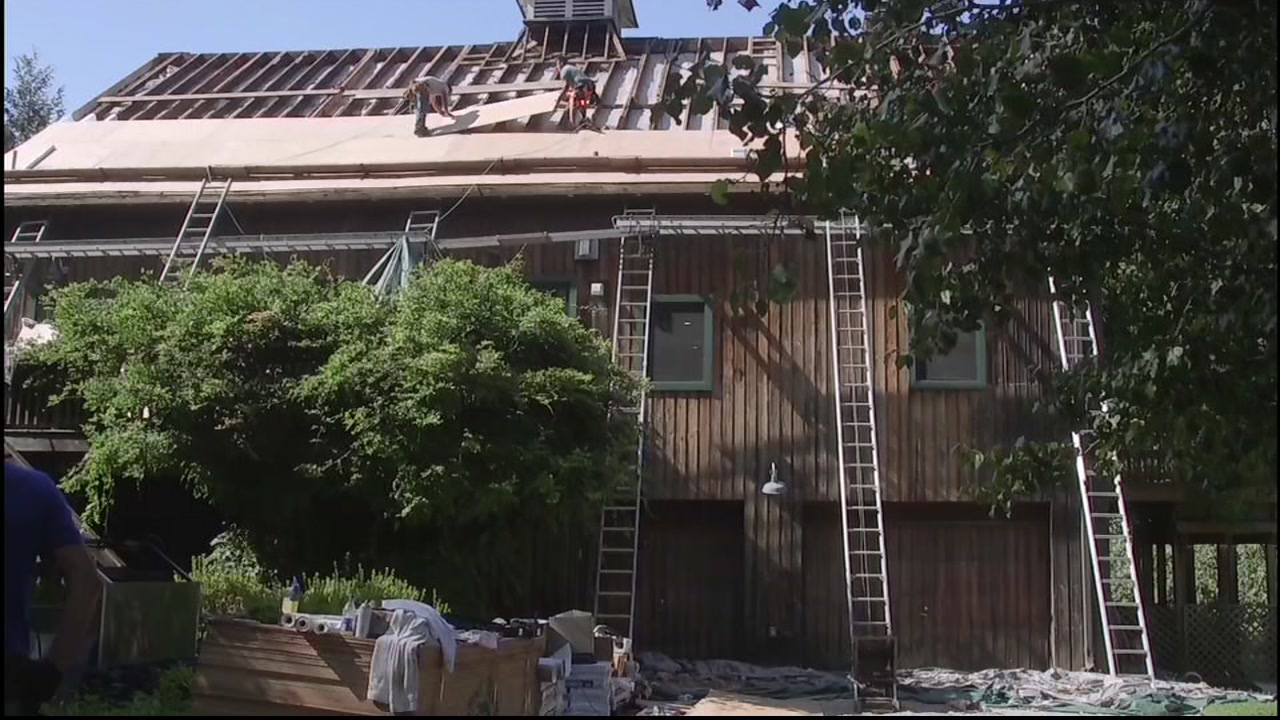 Crews install a new roof on a home in this undated file photo.