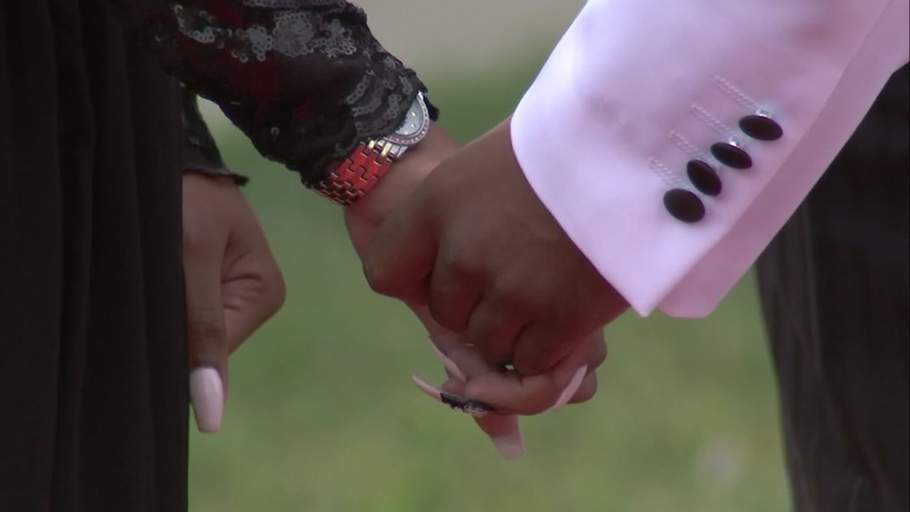 Patrice Treadwell and AJ Collins hold hands during their wedding ceremony on Sept. 14, 2018, in Oakland, Calif.