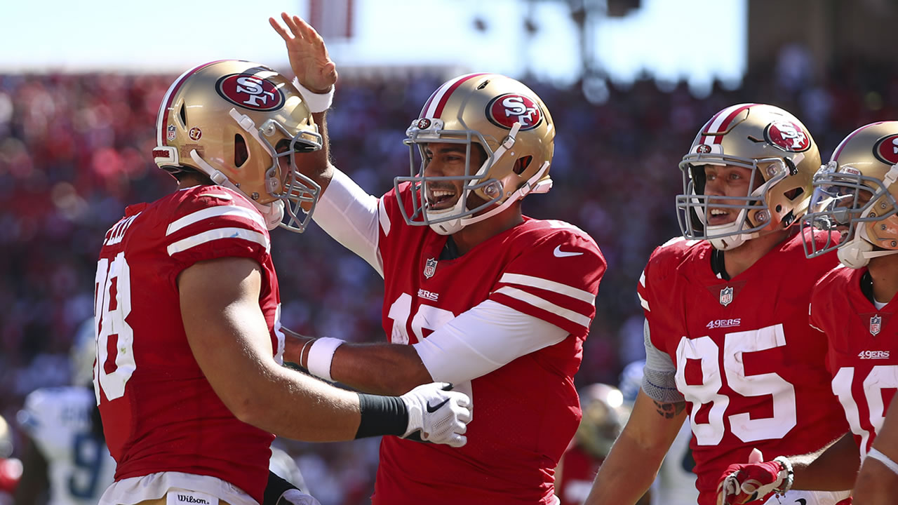 49ers Garrett Celek is greeted by Jimmy Garoppolo after scoring a touchdown during an NFL football game against the Detroit Lions in Santa Clara, Calif., Sunday, Sept. 16, 2018.